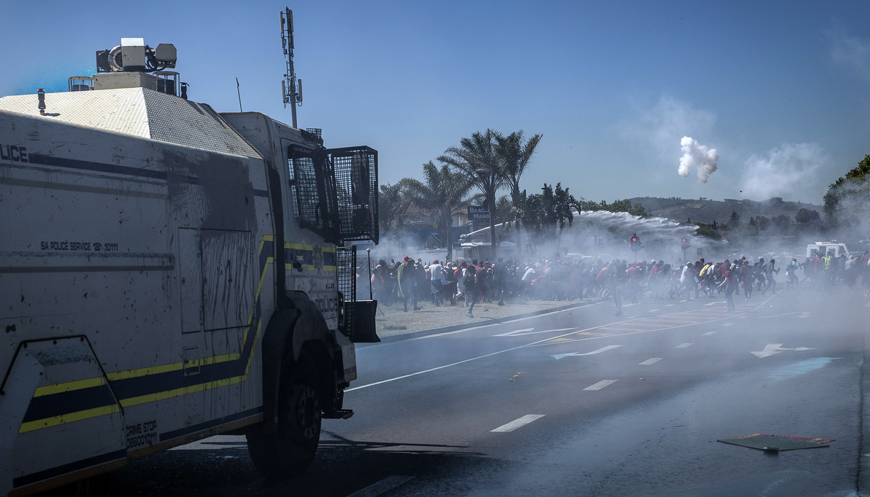 South African police fire teargas at anti-racism protesters